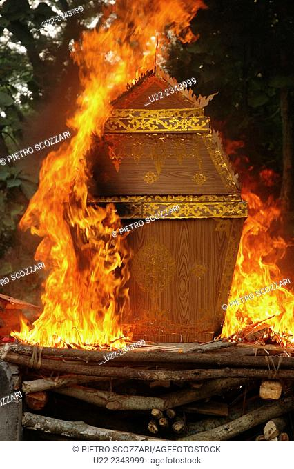 Ban Xieng Maen, village near Luang Prabang, Laos: coffin burnt on a pyre during a Buddhist funeral