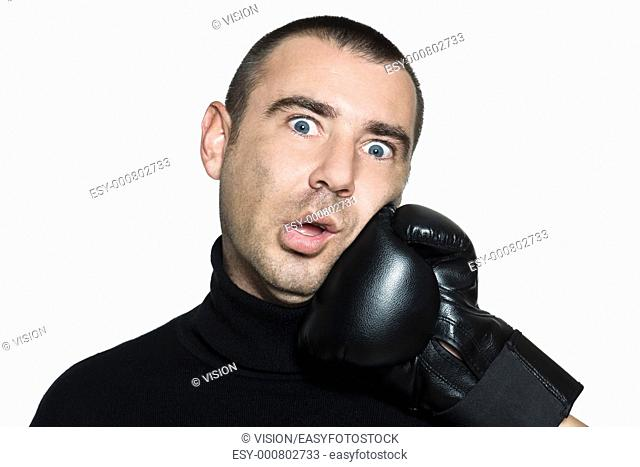 studio shot portrait on isolated white background of a Funny man hit by a boxing glove
