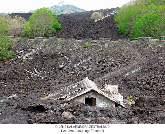 A house is covered with cooled lava from Mount Etna near Zafferana Etnea,Sicily, Italy, 07 May 2013. With a height of 3,323 meters
