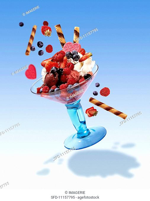 A flying ice cream sundae with flying decorations