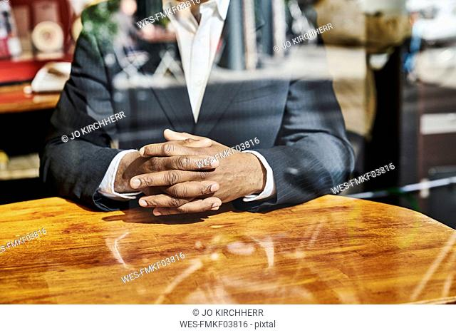 Mature businessman sitting in snack bar