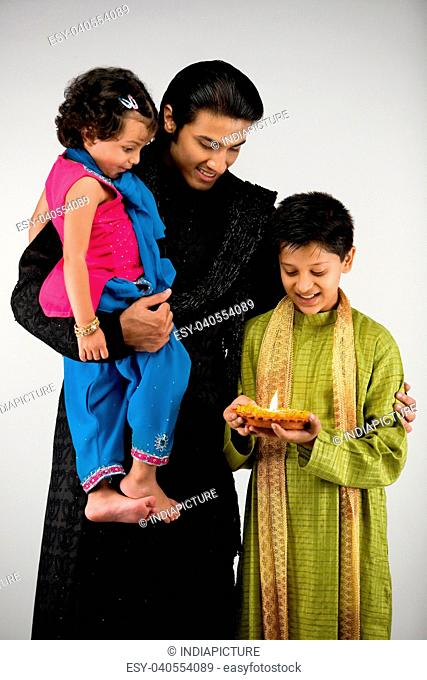 Father with children celebrating diwali
