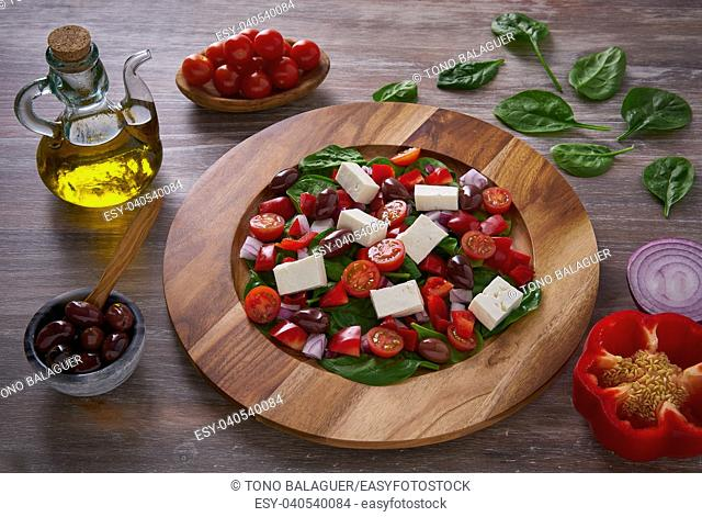 Cheese salad with tomatoes spinach and kalamata olives