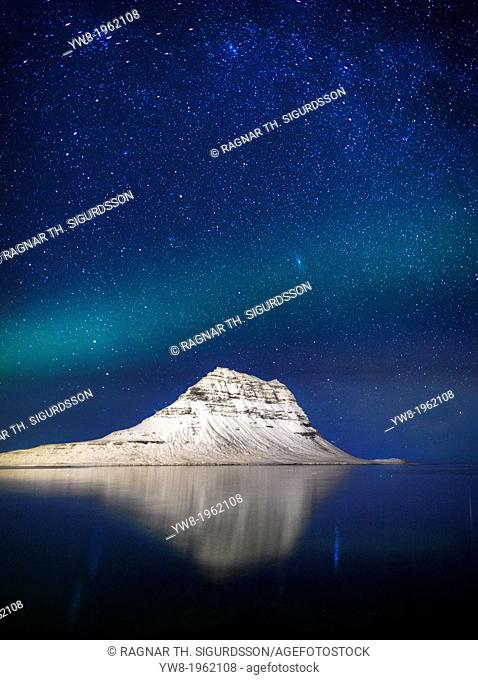 Aurora Borealis or Northern lights with the Milky Way Galaxy over fjord. Mt. Kirkjufell, Grundarfjordur, Snaefellsnes Peninsula, Iceland