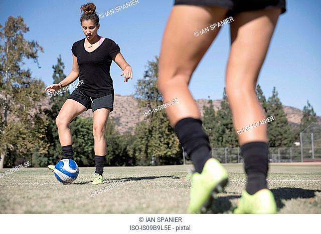Women on football pitch playing football