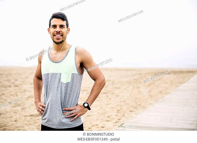 Portrait of smiling athlete on the beach