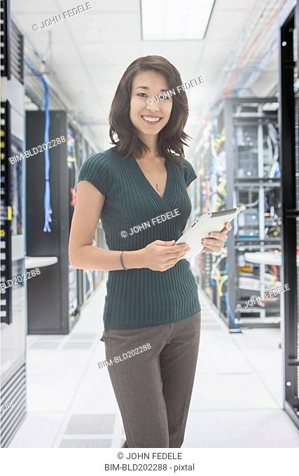 Mixed race businesswoman in server room