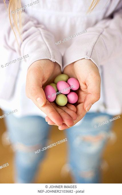 Hands with chocolate eggs