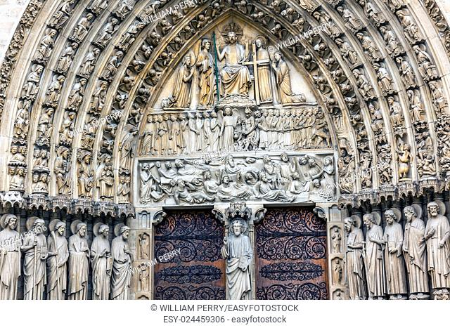 Judgement Door Biblical Statues Notre Dame Cathedral Paris France. Notre Dame was built between 1163 and 1250AD