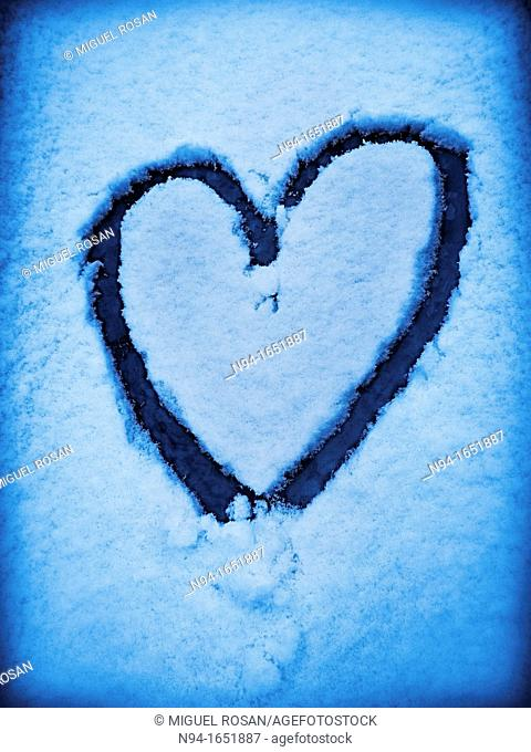 Heart drawn with the finger on ice