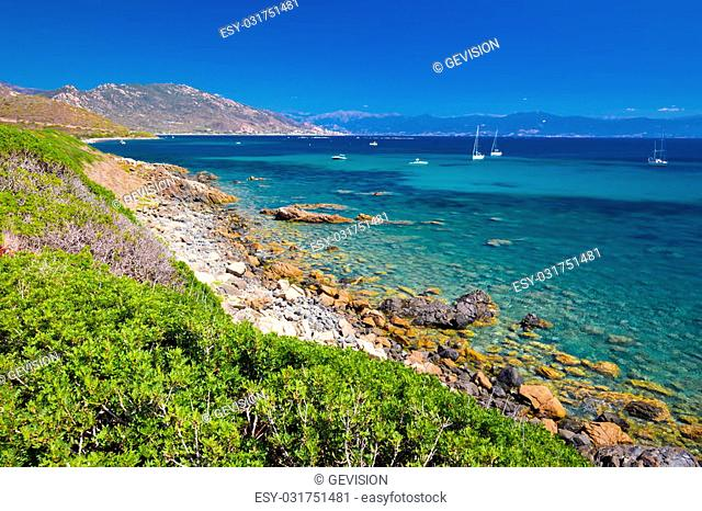 Stunning Corsica coastline with rocky beach and tourquise clear water, Corsica, France, Europe