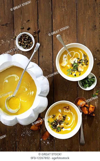 Pumpkin and turmeric soup with coconut, tofu and toasted pumpkin seeds