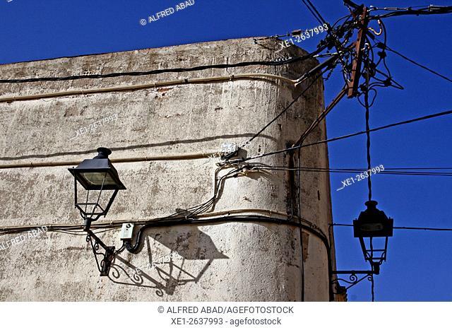Wall attached to lampposts, La Nou de Gaia, Tarragona, Catalonia, Spain