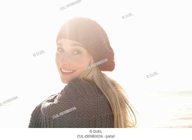 Young woman in beret enjoying sunny day