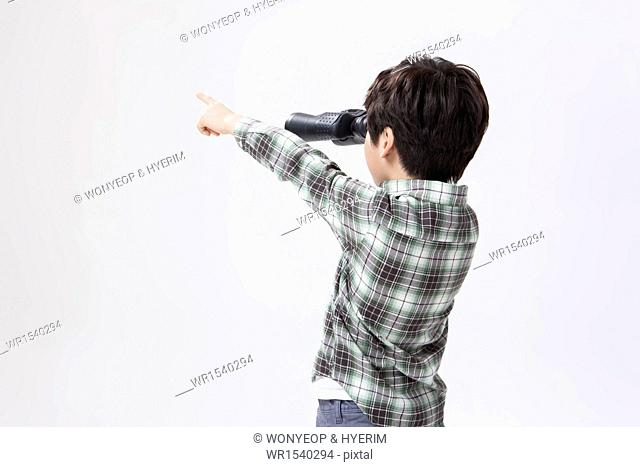 a boy looking with binoculars