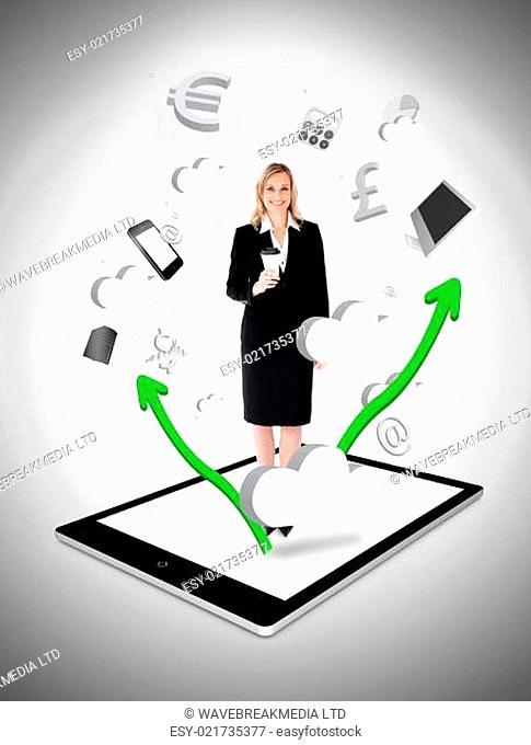 Cheerful businesswoman holding a coffee on a digital tablet pc