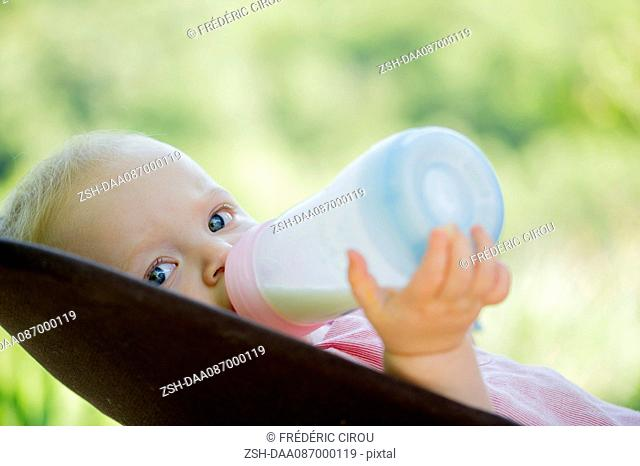 Infant drinking milk from bottle