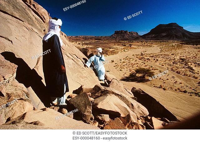 Tuaregs on a hill, Hoggar Mountains. South Sahara, Algeria
