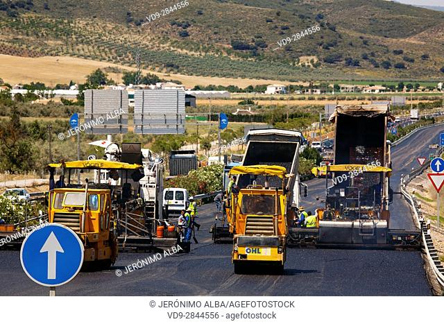 Industrial truck laying asphalt on road in construction. Andalusia Spain, Europe