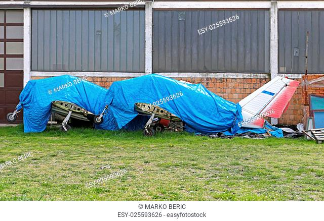 Light Aircrafts Grounded and Covered With Tarp