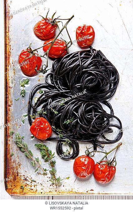 Black spaghetti with tomato sauce