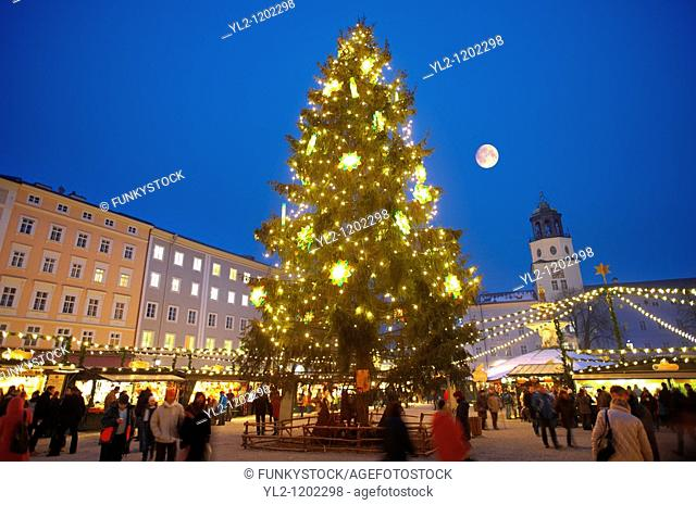 Christmas market stalls and Christmas tree at night at Satlzburgh market - Austria