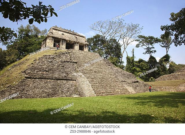 Tourist standing in front of the Temple Of Conde-Templo Del Conde in Mayan Archaeological Site Palenque, Chiapas State, Mexico, Central America