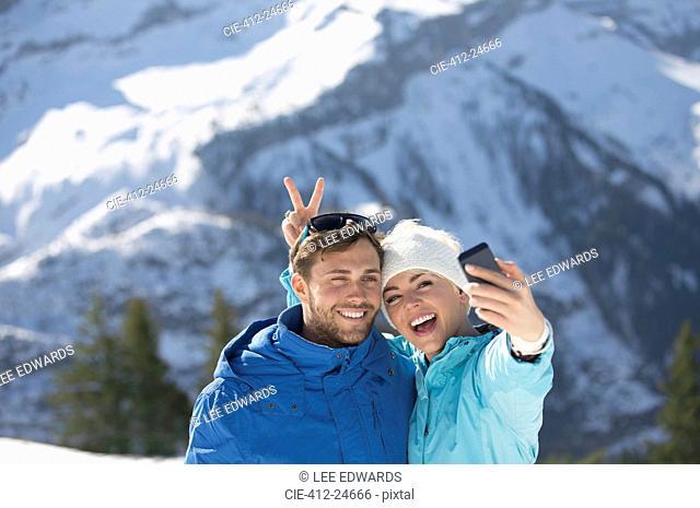 Couple taking selfie in snow