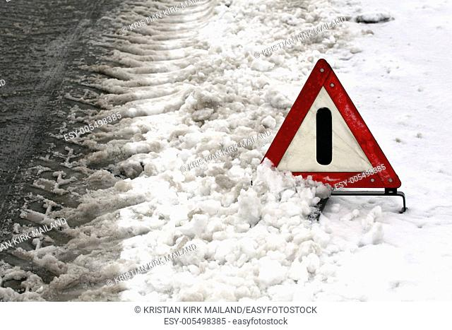 Accident. Warning triangle on winter road. Denmark