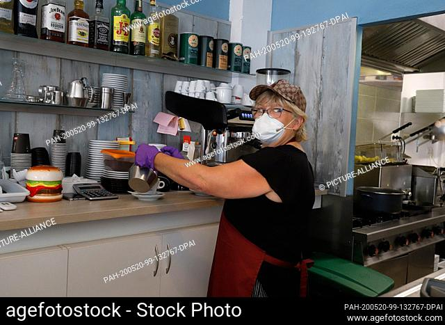 20 May 2020, Spain, Calvia: The German Hannelore Schiller, owner of the restaurant Essbar, prepares a coffee in her restaurant on the beach of Paguera on the...
