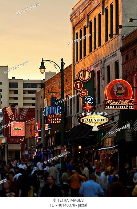 Crowd of people and buildings on Beale Street in Memphis