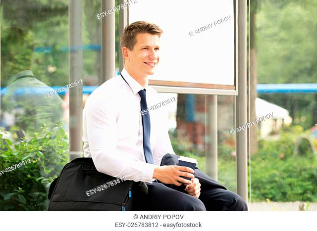 Young Businessman Going to Work Waiting At Bus Stop