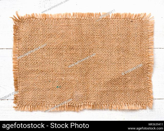 Sacking cloth on a wooden background