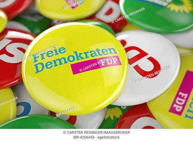 German political party FDP button in front between other governing party buttons