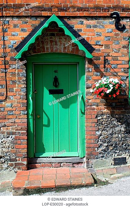 England, Buckinghamshire, West Wycombe, Traditional cottage front door in West Wycombe. West Wycombe village is owned by the National Trust