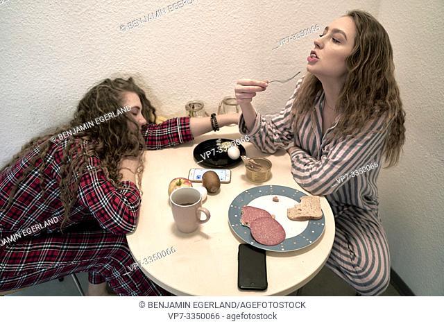 tired women eating breakfast, early morning