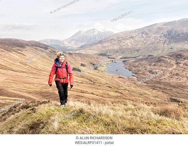 UK, Scotland, Onich, Beinn Na Gucaig, woman hiking in mountain scenery