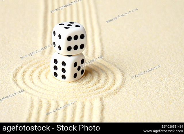 Composition on Zen garden - sand, and two dice