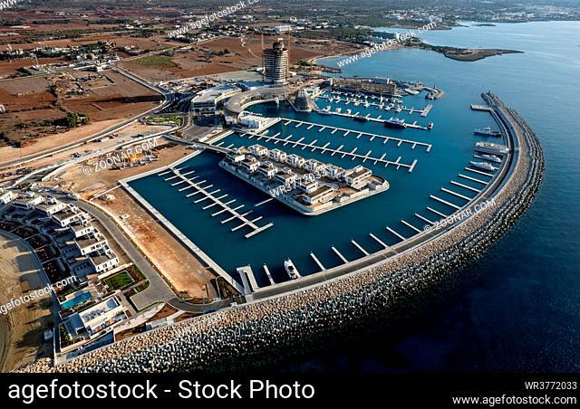 Aerial drone view of ayia napa new marina and tourist yachts moored at the marina. Agia Napa harbor Cyprus