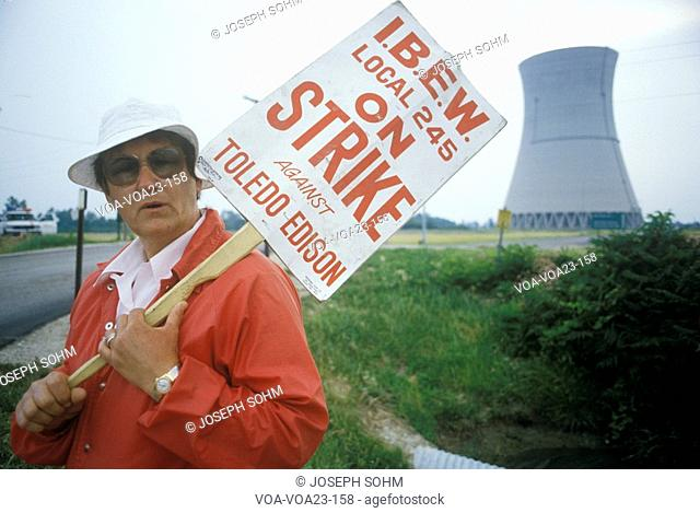 Striker with placard at Davis-Besse Nuclear Power Station, OH