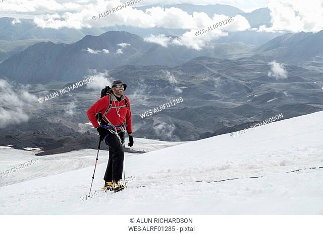 Russia, Upper Baksan Valley, Caucasus, Mountaineer ascending Mount Elbrus