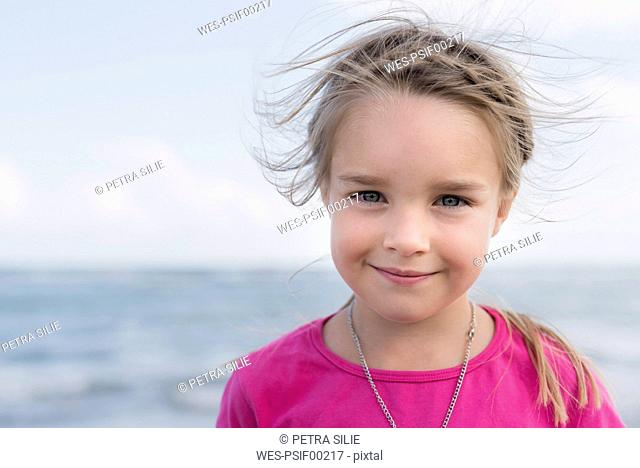 Portrait of smiling little girl at the sea