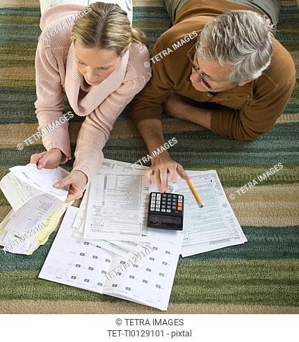 Couple preparing taxes