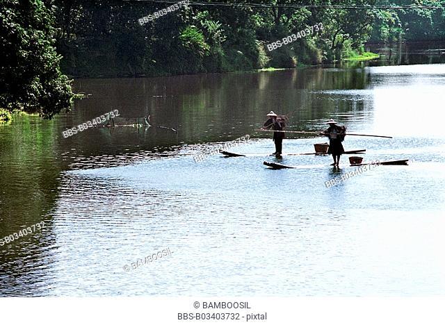 Men traveling on bamboo rafts, Yanshou Village, Chengxian District, Putian City, Fujian Province, People's Republic of China