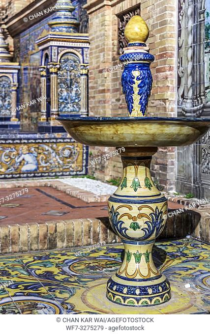 Seville, Spain - Dec 2018: A ceramic titled fountain ornate at a alcove at Spain Square