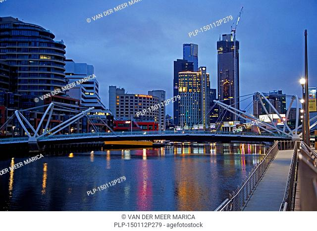 Bridge over the Yarra River and skyline with skyscrapers of the Melbourne City Centre at sunset, Victoria, Australia