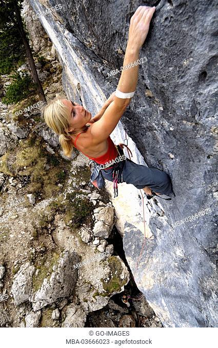 Woman, climbing at the Sellapass, South Tirol