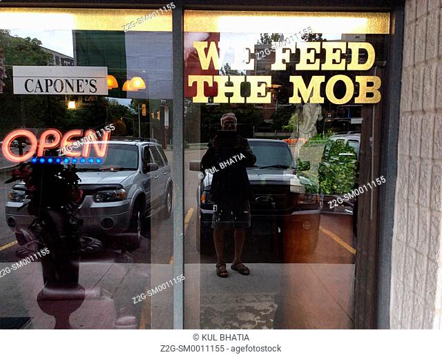 Feed the mob sign in an Italian restaurant, Ontario, Canada