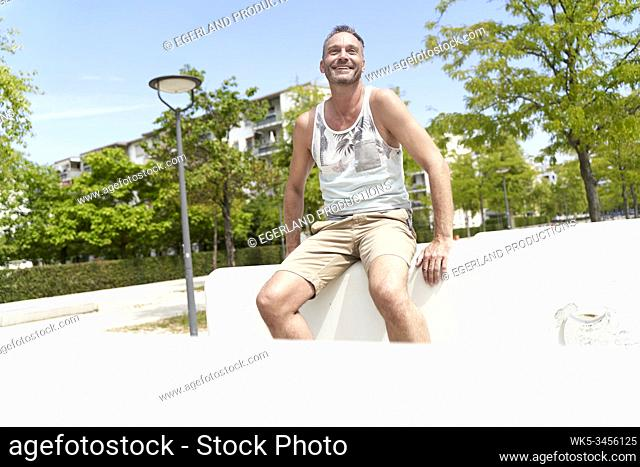 Mature man in playground. Munich, Germany