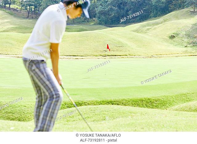 Japanese golf player on course